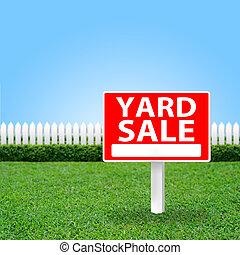 Yard Sale sign on grass field.