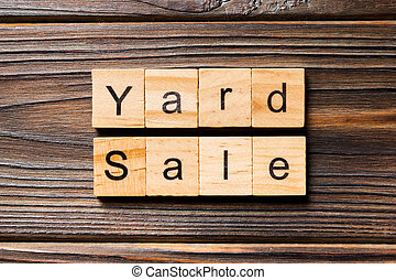 Yard sale word written on wood block. Yard sale text on wooden table for your desing, Top view concept