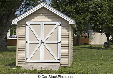Yard Shed - Small beige shed with ramp in backyard. Cute...