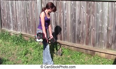 Yard Work - Teen girl using string trimmer