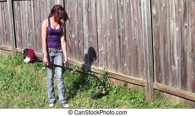 Yard Work - Teen girl using string trimmer
