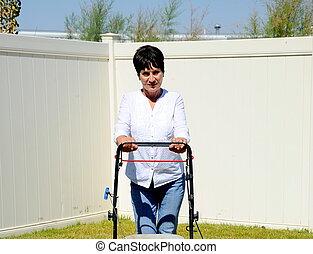 Yardwork outdoors. - Mature female beauty doing yardwork...