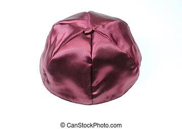 Yarmulke - A purple yarmulke, a Jewish head covering, on...