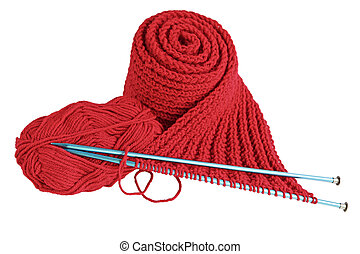 Red yarn and needles making scalf isolated on white