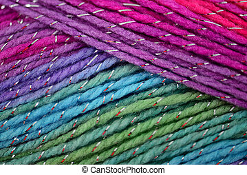 Background of yarn with lurex. Eight different colors