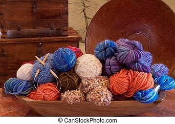 huge pile of yarn in a giant decorative bowl