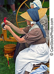 Yarn maker - Colonial women makeing yarn from a spinning...
