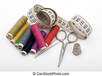 Yarn, Needles, Scissor and Thimble - Nine yarn threads, a...