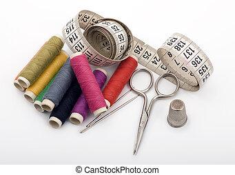 Yarn, Needles, Scissor and Thimble - Nine yarn threads, a...