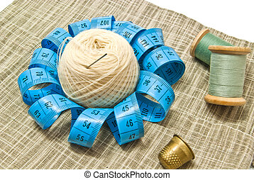 yarn, thimble and spools of thread