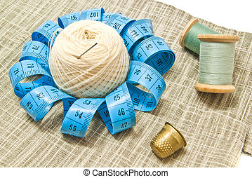 yarn, thimble and two spools of thread