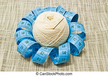 yarn with needle and meter