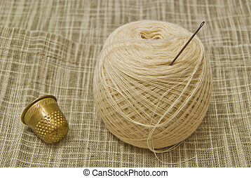 yarn with needle and thimble