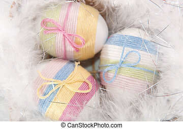 Yarn wrapped Easter eggs - Three yarn wrapped Easter eggs in...