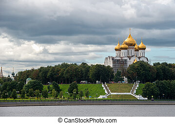 Yaroslavl, Russia - August 14, 2020: View of the Assumption Cathedral and the Volga embankment, located in the historical part of the city of Yaroslavl, from the Volga river. Yaroslavl is part of the Golden Ring of Russia.
