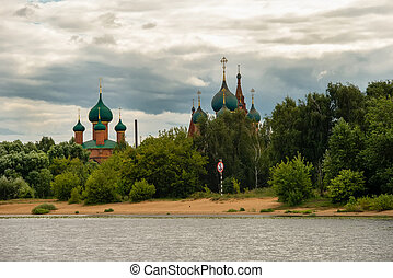 Yaroslavl, Russia - August 14, 2020: View of the Temple complex in Korovniki, at the confluence of the Volga and Kotorosl rivers. Yaroslavl is part of the Golden Ring of Russia.