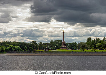 Yaroslavl, Russia - August 14, 2020: View on a cloudy summer day at the monument to the Millennium of Yaroslavl, located in Strelka Park, at the confluence of the Volga and Kotorosl rivers. Yaroslavl is part of the Golden Ring of Russia.