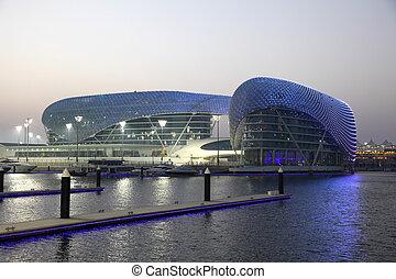 Yas Marina Hotel illuminated at night. Abu Dhabi, United Arab Emirates