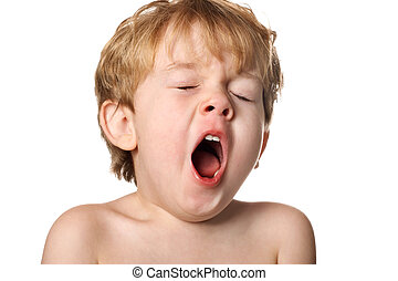 Yawn - A tired boy opens his mouth in a yawn
