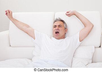 Yawning Mature Man Stretching His Arm - Portrait Of Yawning...