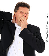 Yawning - Tired middle-aged man. All on white background.