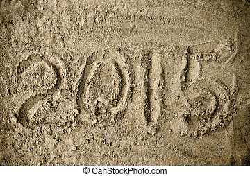 Year 2015 handwritten on the beach sand