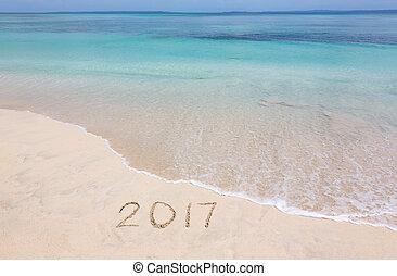 Year 2017 on sandy beach - Happy New Year 2017 creative on...