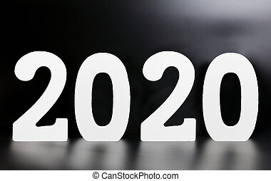 year 2020 made from wooden white numbers on a black background