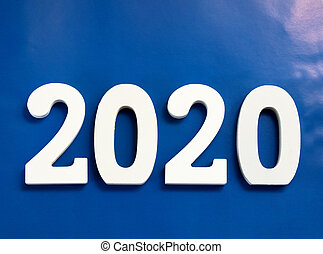 Year 2020 made from wooden white numbers on a blue background