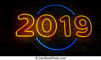 Year 2020 neon light on brick wall background. Glowing large...
