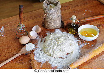 yeast dough - yeast dough, eggs and flour on wooden...