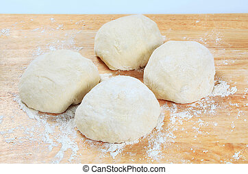 Yeast dough on a rolling board