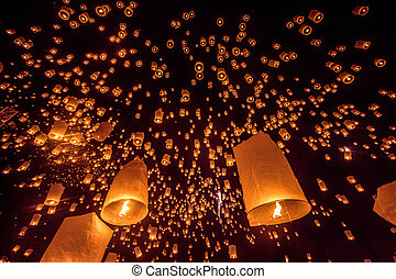 Yee Peng festival, Buddhist floating lanterns to the Buddha in Sansai district, Chiang Mai, Thailand.