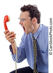 Yell - Angry businessman yelling loud in red telephone...