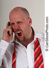 yelling man - An angry man yelling on a mobile phone in...