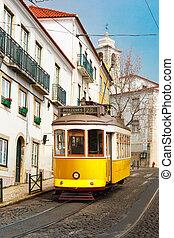 Yellow 28 tram in Alfama, Lisbon, Portugal