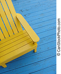 Adirondack chair - Yellow Adirondack chair on a blue porch