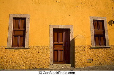 Yellow Adobe House Brown Doors Morelia Mexico - Bright...