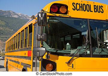 Yellow american schoolbus background closeup