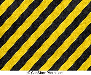 Yellow and black diagonal hazard stripes background