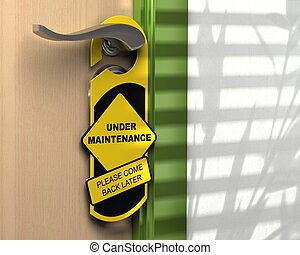 yellow and black hanger where it is written under...