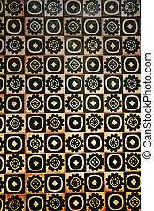 Yellow and black spanish tile with different pattern