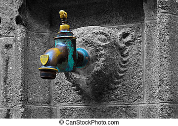 Yellow and Blue Faucet on a Wall