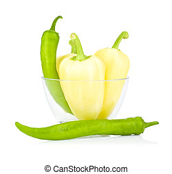 Yellow and green bell peppers bitter in Glass bowl isolated on a white background