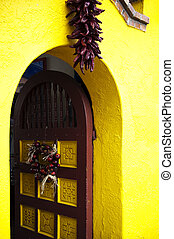 Yellow and oxen red door - in old Downtown Tucson
