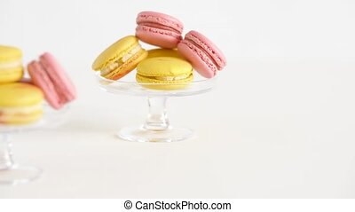 yellow and pink macarons on glass stands - sweets, pastry...