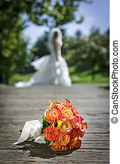 Yellow and pink wedding bouquet with white ribbon
