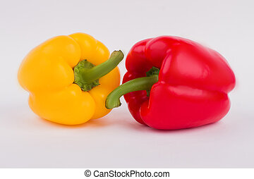 Yellow and red bell peppers close up.