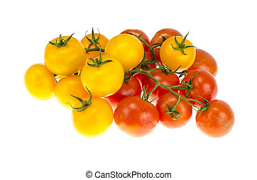 Yellow and red cherry tomatoes on white background