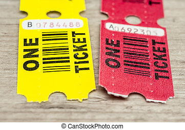 Yellow and red paper tickets